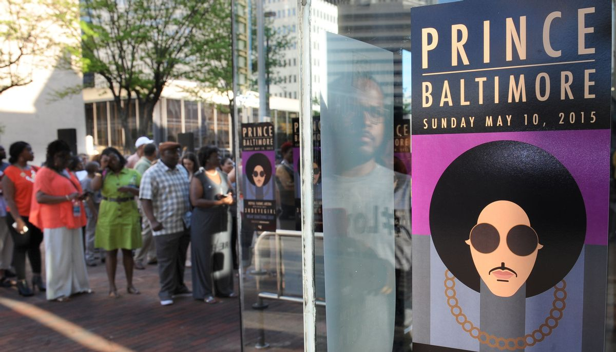 Fans line up outside Royal Farms Arena before Prince's Baltimore concert Sunday, May 10, 2015. (Jerry Jackson/The Baltimore Sun via AP) (AP)
