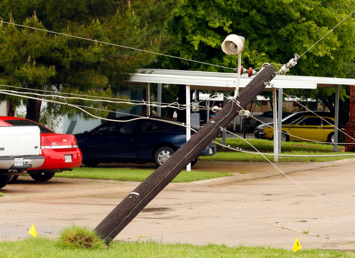 A power pole leans along Fort Worth Avenue after a storm in Denton, Texas, Sunday, May 10, 2015. Several Great Plains and Midwest states were in the path of severe weather, including in North Texas, where the National Weather Service said a likely tornado damaged roofs and trees near Denton. (Richard W. Rodriguez/The Fort Worth Star-Telegram via AP)  MAGS OUT; (FORT WORTH WEEKLY, 360 WEST); INTERNET OUT (AP)