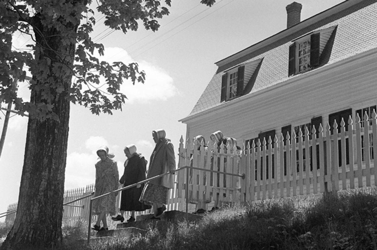 Three Shaker sisters, leaving the old meeting house in Sabbathday Lake, Me., June 7, 1962.  (AP)