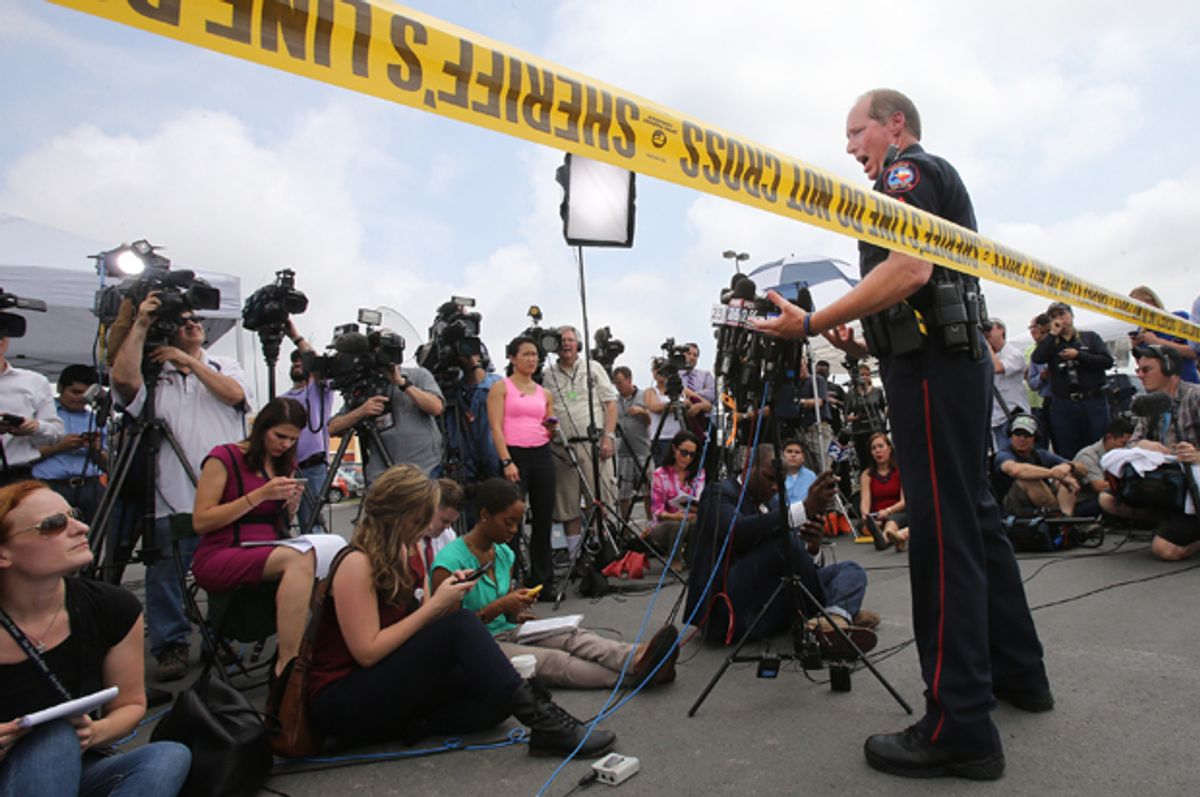 Waco Police Sgt. Patrick Swanton addresses the media as law enforcement continues to investigate the motorcycle gang related shooting at the Twin Peaks restaurant, Monday, May 18, 2015, in Waco, Texas.    (AP/Jerry Larson)
