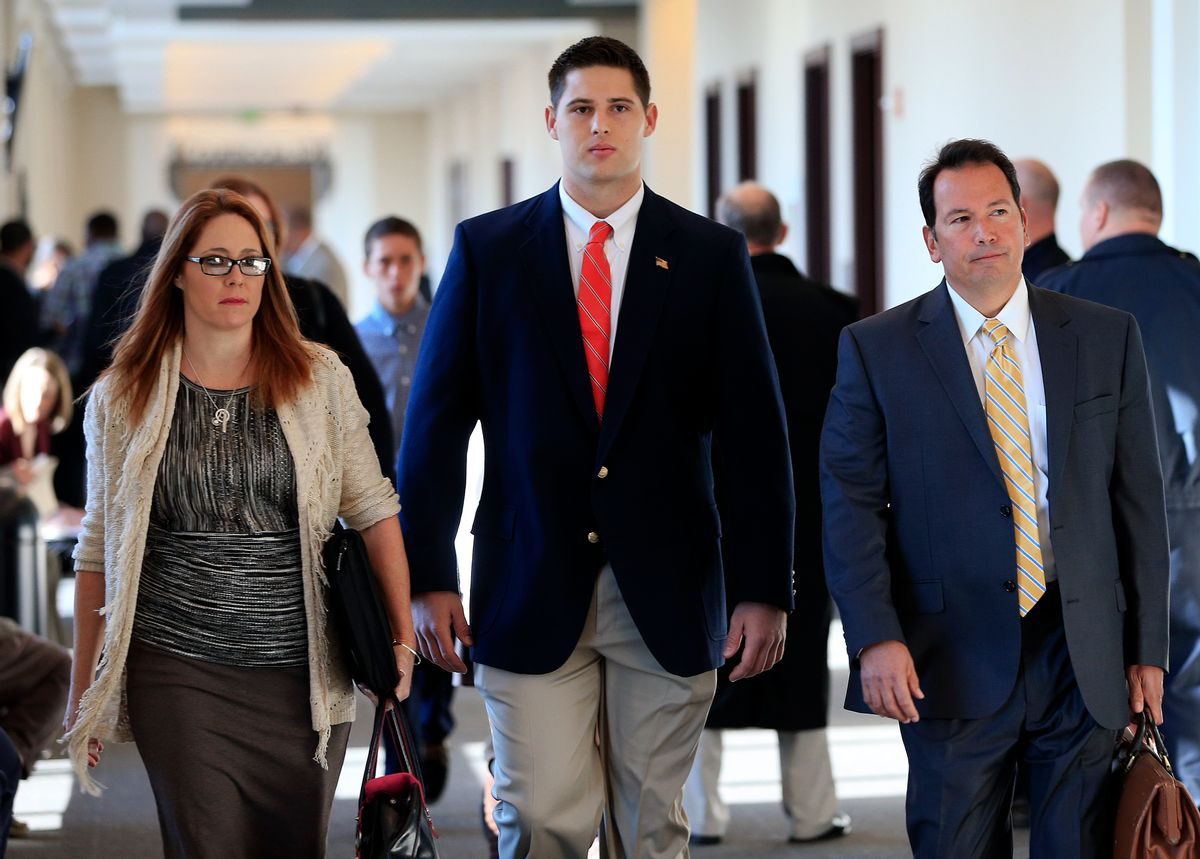 Former Vanderbilt University football player Brandon Vandenburg, center, arrives for jury selection in his trial Monday, Nov. 3, 2014, in Nashville, Tenn. Vandenburg and former teammate Cory Batey are charged with the rape of an unconscious 21-year-old female student on June 23, 2013. (AP Photo/Mark Humphrey)    (AP/Mark Humphrey)