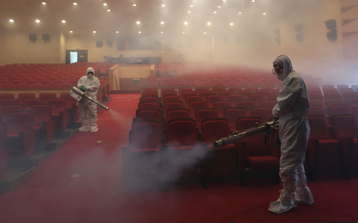 AP10ThingsToSee - Workers wearing protective suits fumigate an art hall with antiseptic solution as a precaution against the spread of the MERS (Middle East Respiratory Syndrome) virus in Seoul, South Korea on Friday, June 12, 2015. (AP Photo/Lee Jin-man) (AP)