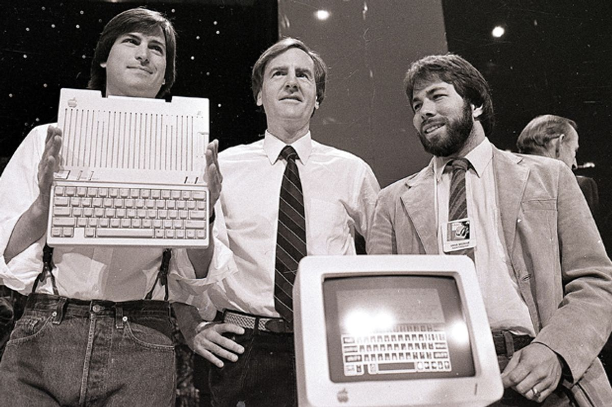 Steve Jobs, John Sculley, and Steve Wozniak unveil the later Apple IIc computer, April 24, 1984.          (AP/Sal Veder)