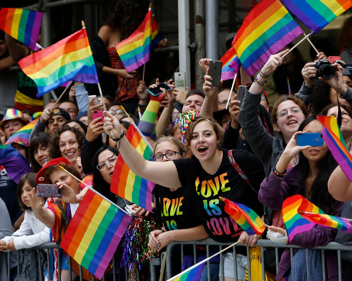 A crowd waves rainbow flags during the Heritage Pride March in New York, Sunday, June 28, 2015. Large turnouts were expected for gay pride parades across the U.S. following the landmark Supreme Court ruling that said gay couples can marry anywhere in the country. (AP Photo/Kathy Willens) (AP)
