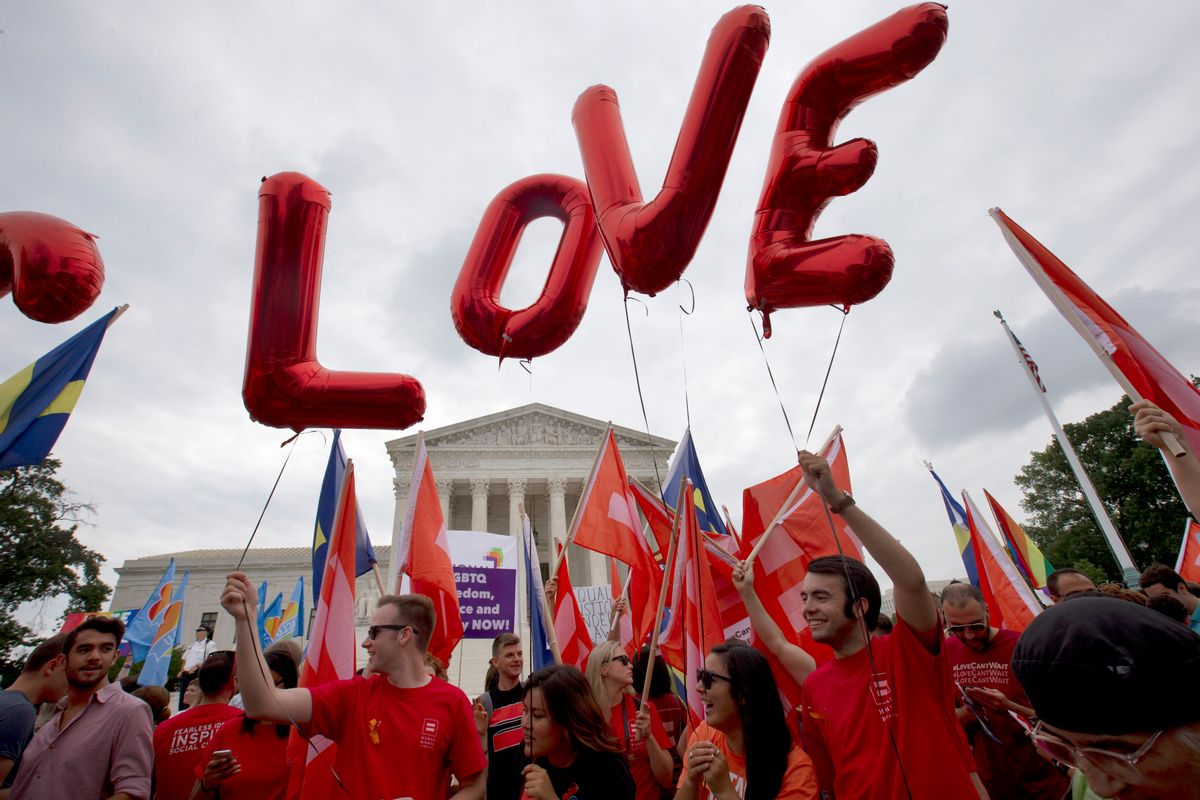"""Balloons spell out the word """"love"""" over the Supreme Court in Washington, Friday June 26, 2015, after the court declared that same-sex couples have a right to marry anywhere in the US.  (AP Photo/Jacquelyn Martin) (AP)"""