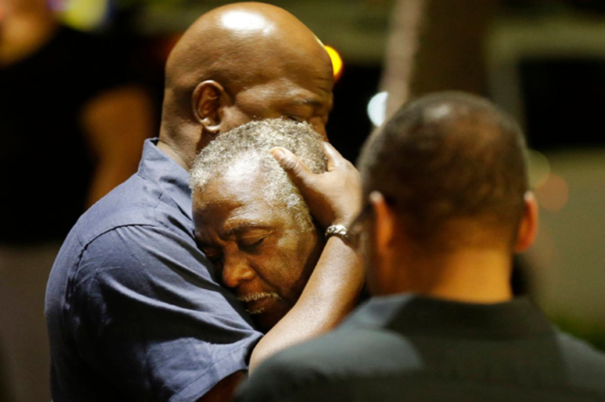 Worshippers embrace across the street from the scene of a shooting at Emanuel AME Church, Wednesday, June 17, 2015, in Charleston, S.C.        (AP/David Goldman)