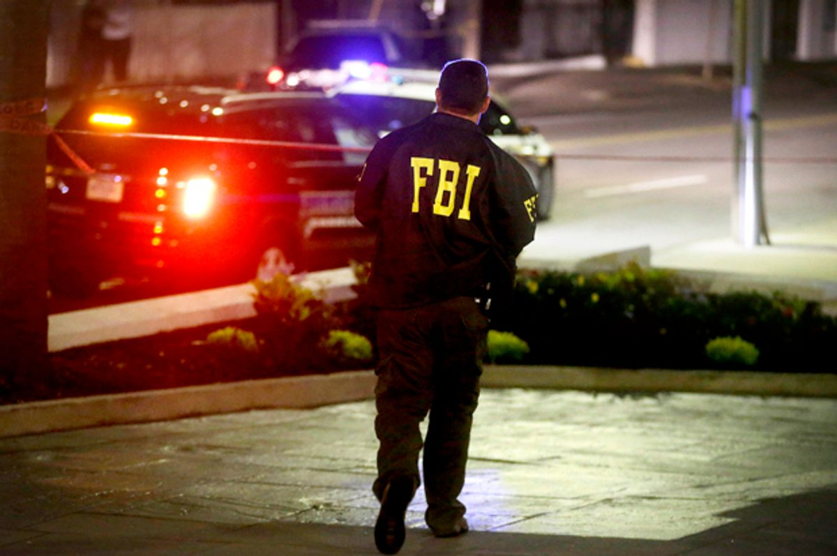 An FBI agent walks across the street from the Emanuel AME Church following the shooting, Wednesday, June 17, 2015, in Charleston, S.C.          (AP/David Goldman)