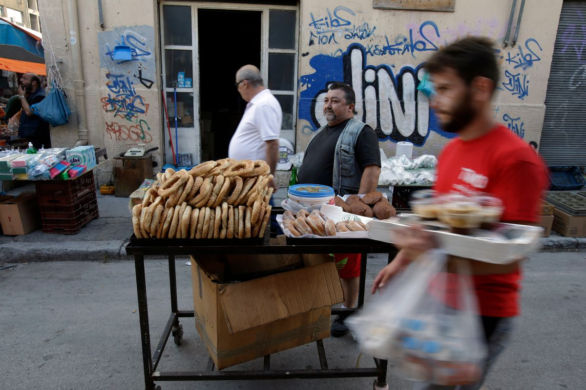A man sells bread rings and donuts at a flea market in the port of Piraeus, near Athens, Sunday, June 28, 2015. (AP Photo/Thanassis Stavrakis) (Thanassis Stavrakis)