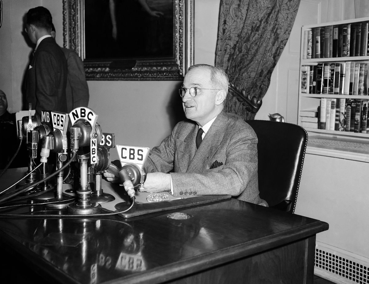 """FILE - In this April 25, 1945, file photo, U.S.  President Harry S. Truman, talks in front of microphones, over which he broadcasts a message opening the conference of 46 United Nations in San Francisco, telling the delegates """"you are to be architects of a better world. In your hands rests our future,"""" in the White House in Washington, D.C. Seventy years ago leaders of 50 war-weary countries gathered in San Francisco to create an international order that would save future generations """"from the scourge of war."""" With that, the United Nations was created. (AP Photo/File) (AP)"""