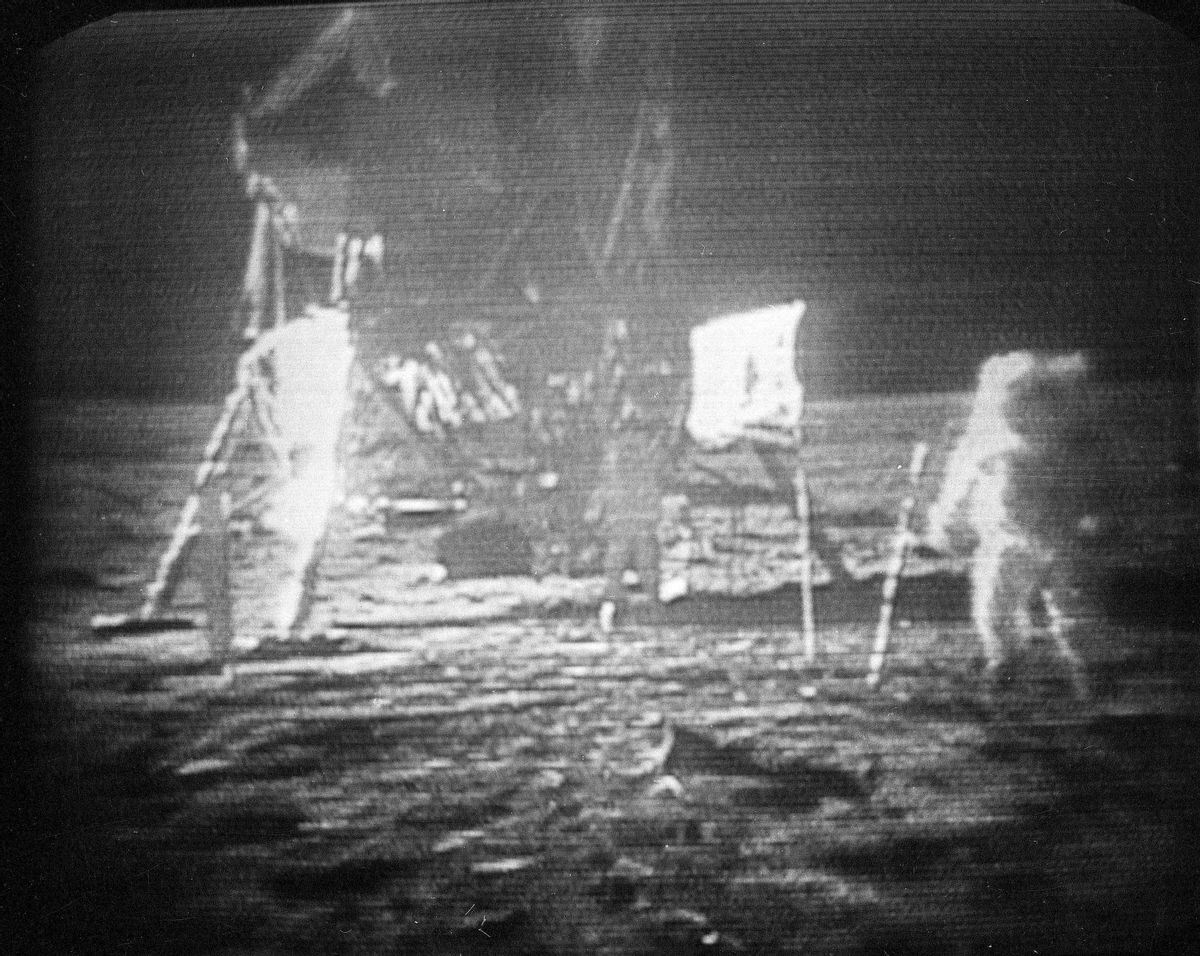 FILE - In this July 20, 1969 file photo, Apollo 11 astronaut Neil Armstrong, right, trudges across the surface of the moon leaving behind footprints. The National Air and Space Museum is launching a crowdfunding campaign to conserve the spacesuit Neil Armstrong wore on the moon. The campaign begins Monday, marking 46 years since Armstrong's moonwalk in 1969. Conservators say spacesuits were built for short-term use with materials that break down over time. The museum aims to raise $500,000 on Kickstarter to conserve the spacesuit, build a climate-controlled display case and digitize the spacesuit with 3D scanning.  (AP Photo, file) (AP)