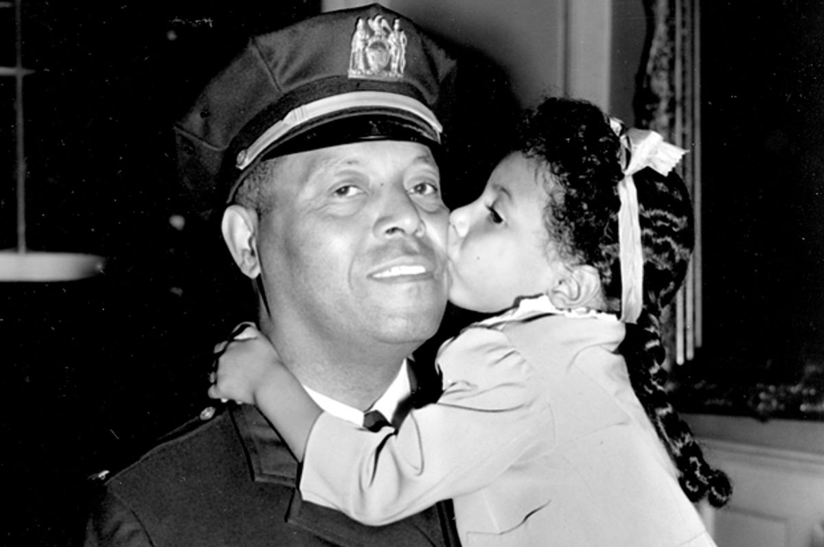 Lt. Samuel Battle gets a kiss from his granddaughter Yvonne, at City Hall in New York, Sept. 4, 1941.      (AP)