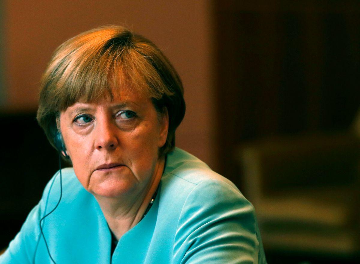 German Chancellor Angela Merkel listens Serbian President Tomislav Nikolic in Belgrade, Serbia, Thursday, July 9, 2015. (AP Photo/Darko Vojinovic)  (Darko Vojinovic)