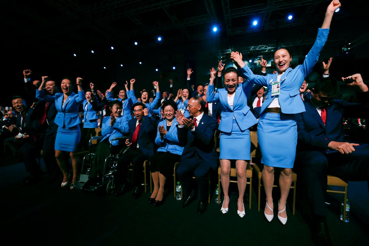 Members from the delegation from Beijing 2022 Winter Olympics candidate city reacts after the city was elected to host the 2022 Olympic Winter Games at IOC meeting in Kuala Lumpur, Malaysia, Friday, July 31, 2015. (AP Photo/Vincent Thian, Pool) (Vincent Thian)