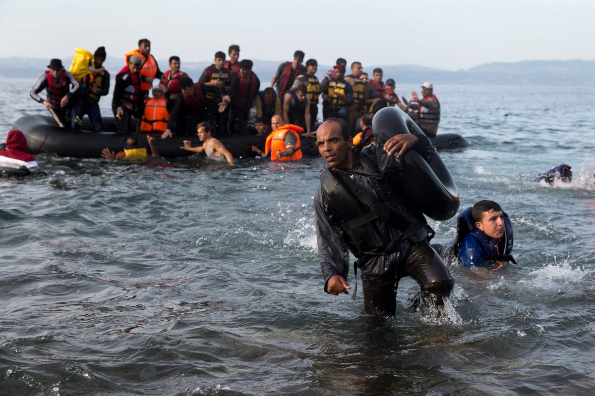 Migrants and refugees arrive on a dinghy after crossing from Turkey to Lesbos island, Greece, Wednesday, Sept. 9, 2015. The head of the European Union's executive says 22 of the member states should be forced to accept another 120,000 people in need of international protection who have come toward the continent at high risk through Greece, Italy and Hungary. (AP Photo/Petros Giannakouris) (AP)
