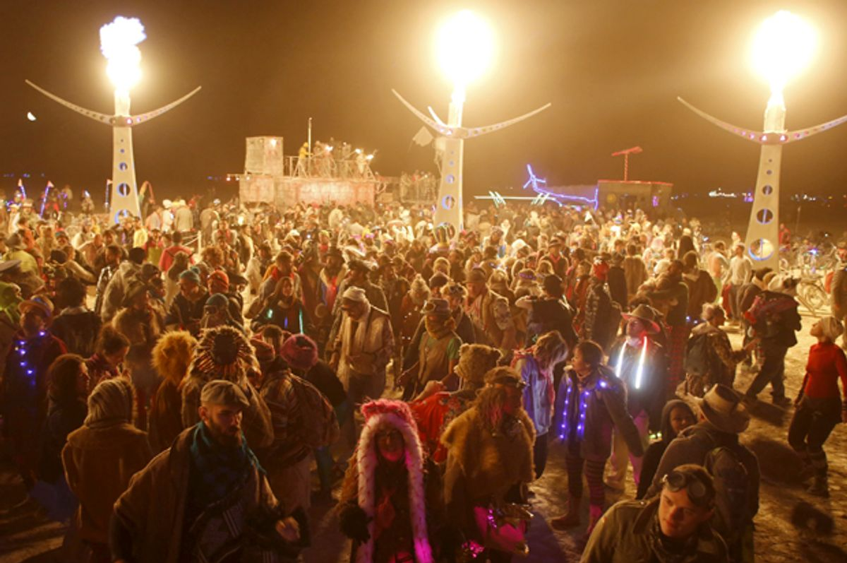 """Participants dance at White Ocean during the Burning Man 2015 """"Carnival of Mirrors"""" arts and music festival in the Black Rock Desert of Nevada, September 4, 2015.  (Reuters/Jim Urquhart)"""