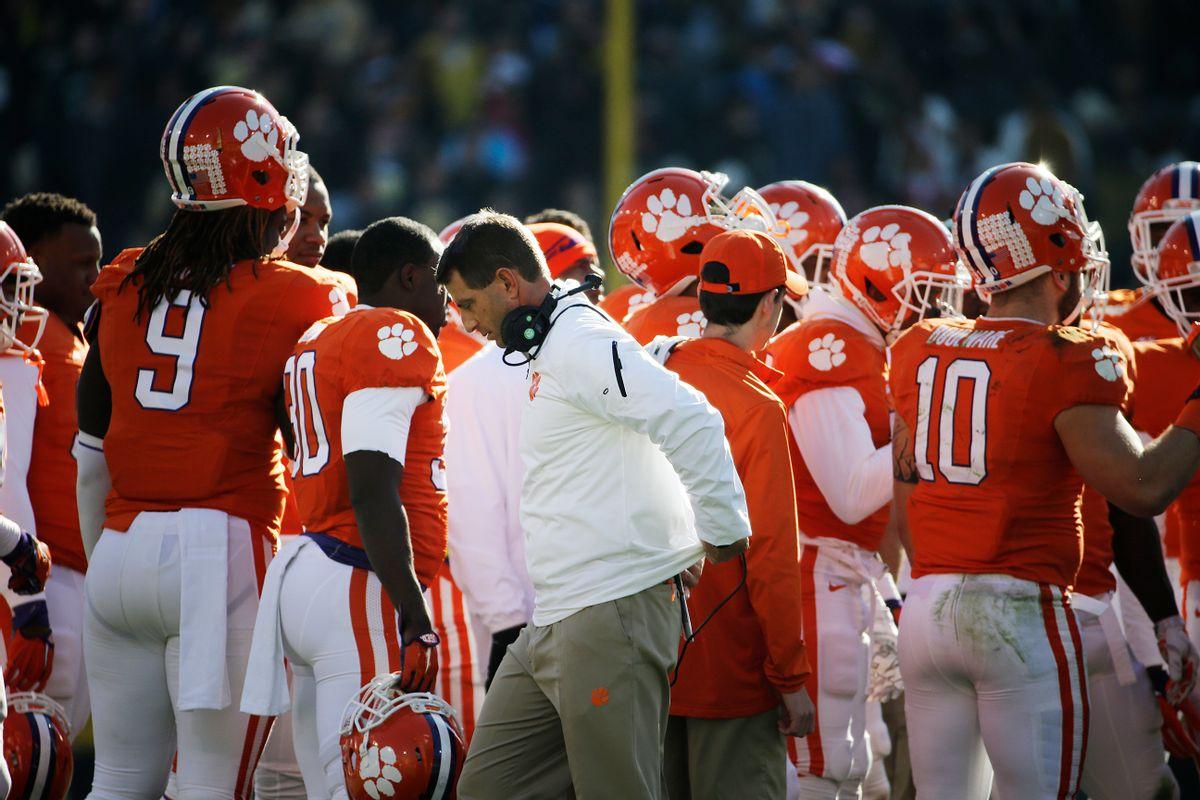 Clemson head coach Dabo Swinney walks away from a huddle in the fourth quarter of an NCAA college football game against Georgia Tech, Saturday, Nov. 15, 2014, in Atlanta. Georgia Tech won 28-6. (AP Photo/David Goldman) (AP)