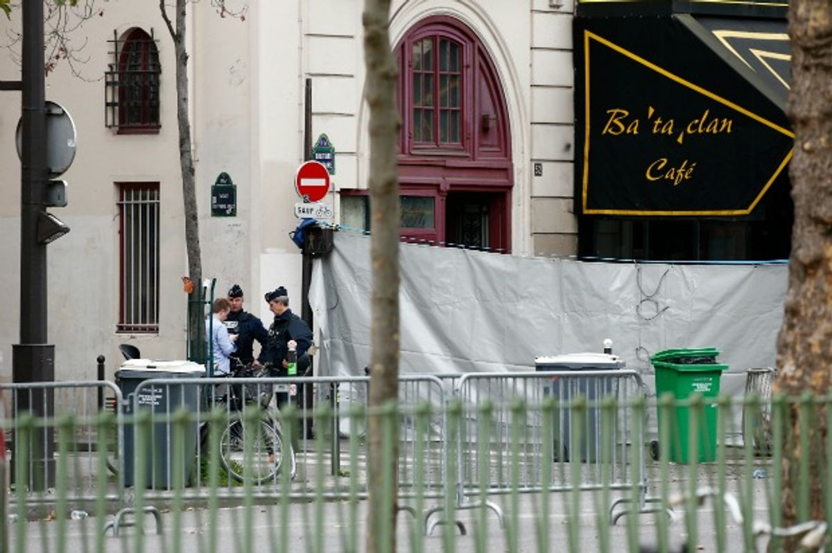 Police work outside the Bataclan Cafe and its adjoining concert hall. (Benoit Tessier/Reuters)