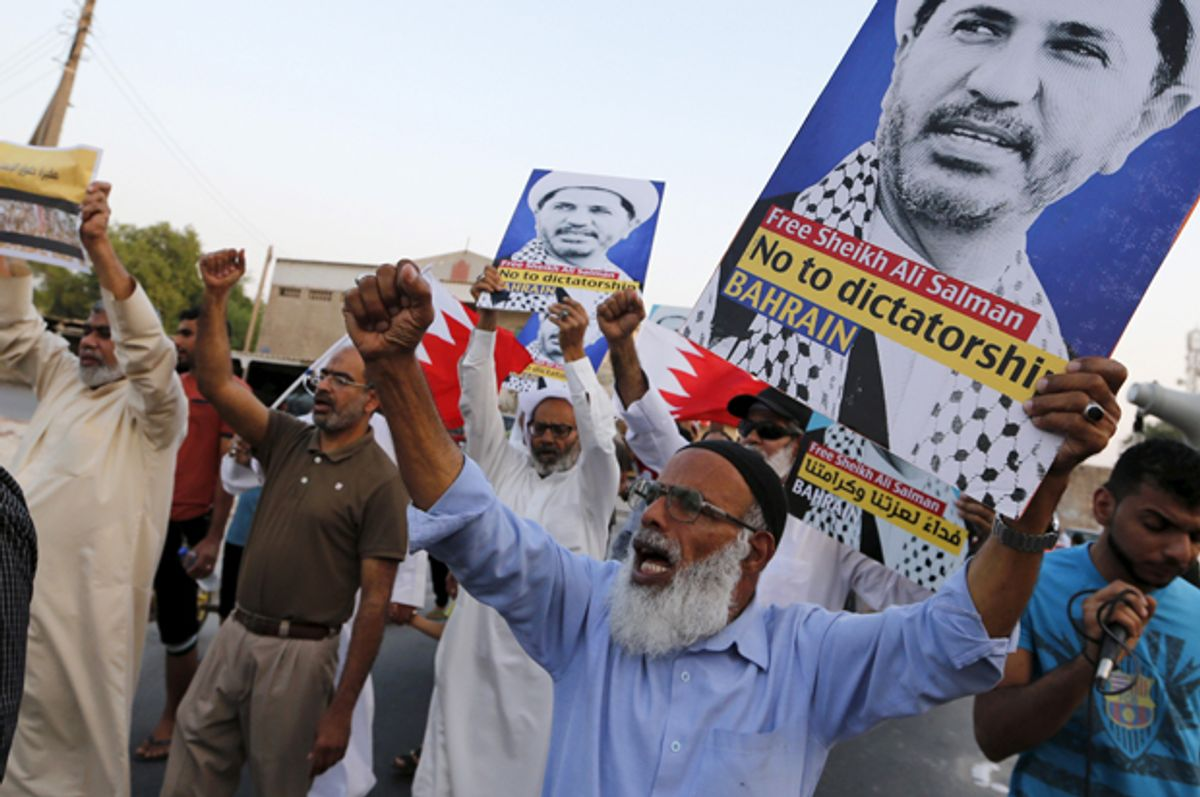 Protesters hold placards with photos of opposition leader and head of Al Wefaq party, Ali Salman, during a protest in the village of Karzakan south of Manama, Bahrain, October 3, 2015.    (Reuters/Hamad I Mohammed)