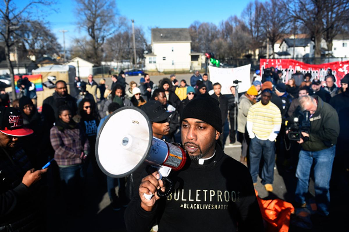 Danny Givens Jr. of St. Paul, Minnesota speaks to a gathering crowd of the group Black Lives Matter before they march to city hall during a protest in Minneapolis, Minnesota November 24, 2015.   (Reuters/Craig Lassig)