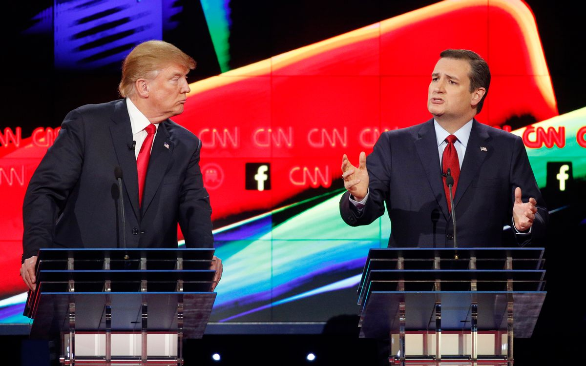 In this Dec. 15, 2015 photo, Donald Trump, left, watches as Ted Cruz speaks during the CNN Republican presidential debate at the Venetian Hotel & Casino in Las Vegas. A growing debate over America's role in promoting regime change in the Middle East is creating unusual alliances among 2016 presidential candidates that cross party lines.  (AP Photo/John Locher) (AP)