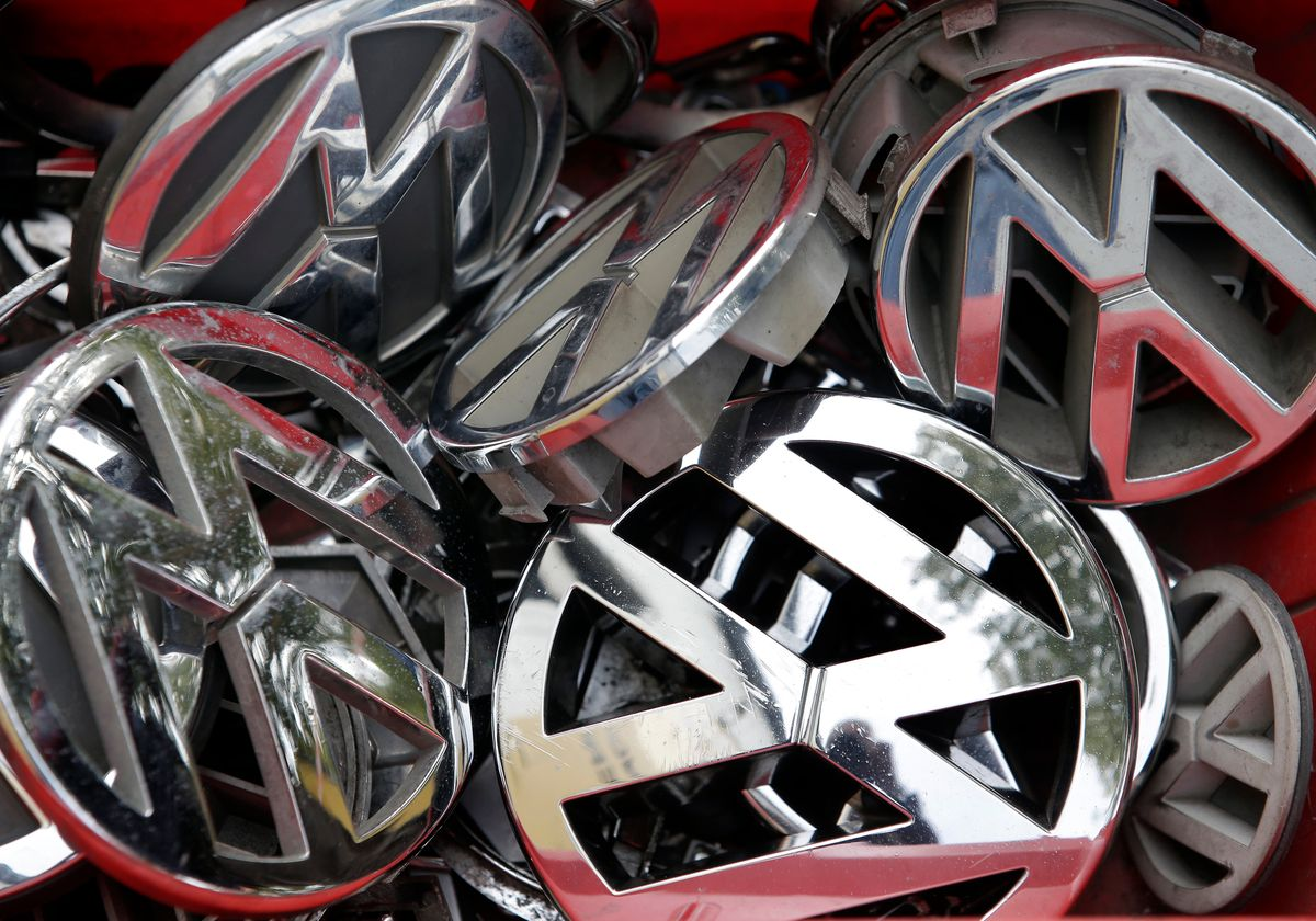 """FILE - In this Sept. 23, 2015 file photo Volkswagen ornaments sit in a box in a scrap yard in Berlin, Germany. Volkswagen said Wednesday, Dec. 9, 2015 that a problem with carbon dioxide emissions is far smaller than initially suspected, with further checks finding """"slight discrepancies"""" in only a few models and no evidence of illegal changes to fuel consumption and emissions figures. (AP Photo/Michael Sohn, file) (AP)"""