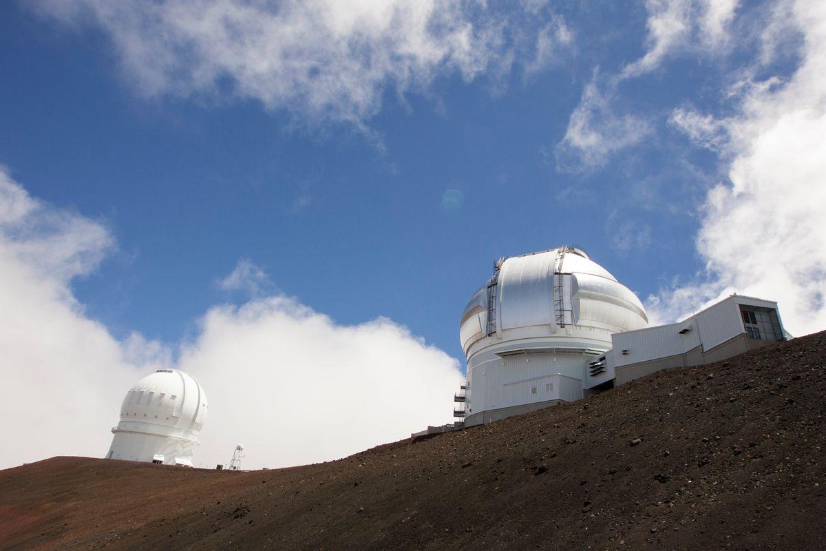 FILE-This Aug. 31, 2015, file photo shows the Gemini Telescope, right, and Canada-France-Hawaii Telescope on Hawaii's Mauna Kea near Hilo, Hawaii. (AP Photo/Caleb Jones, File)
