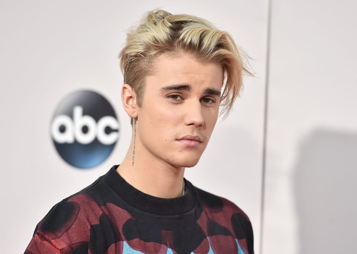 """FILE - In this Sunday, Nov. 22, 2015 file photo, Justin Bieber arrives at the American Music Awards at the Microsoft Theater in Los Angeles. With his recent batch of hit singles and semi-grown-up sound  - including the electro-pop """"Where Are U Now"""" with DJ-producers Skrillex and Diplo - adult men have begun attending the church of Bieber, and while some have issues admitting it, other proudly say they are Beliebers. """"Sorry"""" and """"What Do You Mean,"""" currently at Nos. 2 and 4 on Billboard's Hot 100 chart, helped Bieber solidify his comeback after years of a broken image, which included arrests, public smoking and fainting onstage that led to hospitalization. (Photo by Jordan Strauss/Invision/AP, File) (Jordan Strauss/invision/ap)"""
