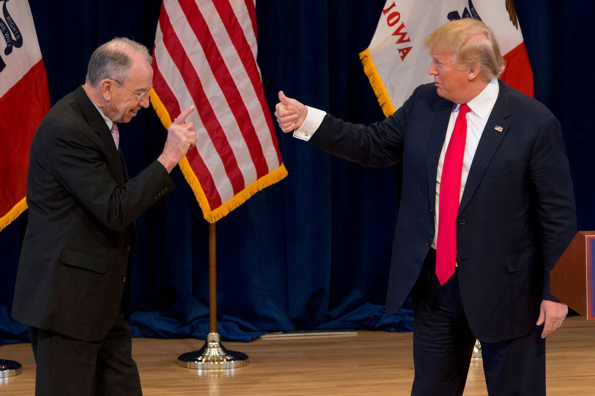 Republican presidential candidate Donald Trump, right, greets Sen. Chuck Grassley, R-Iowa, on stage during a campaign event  (AP)