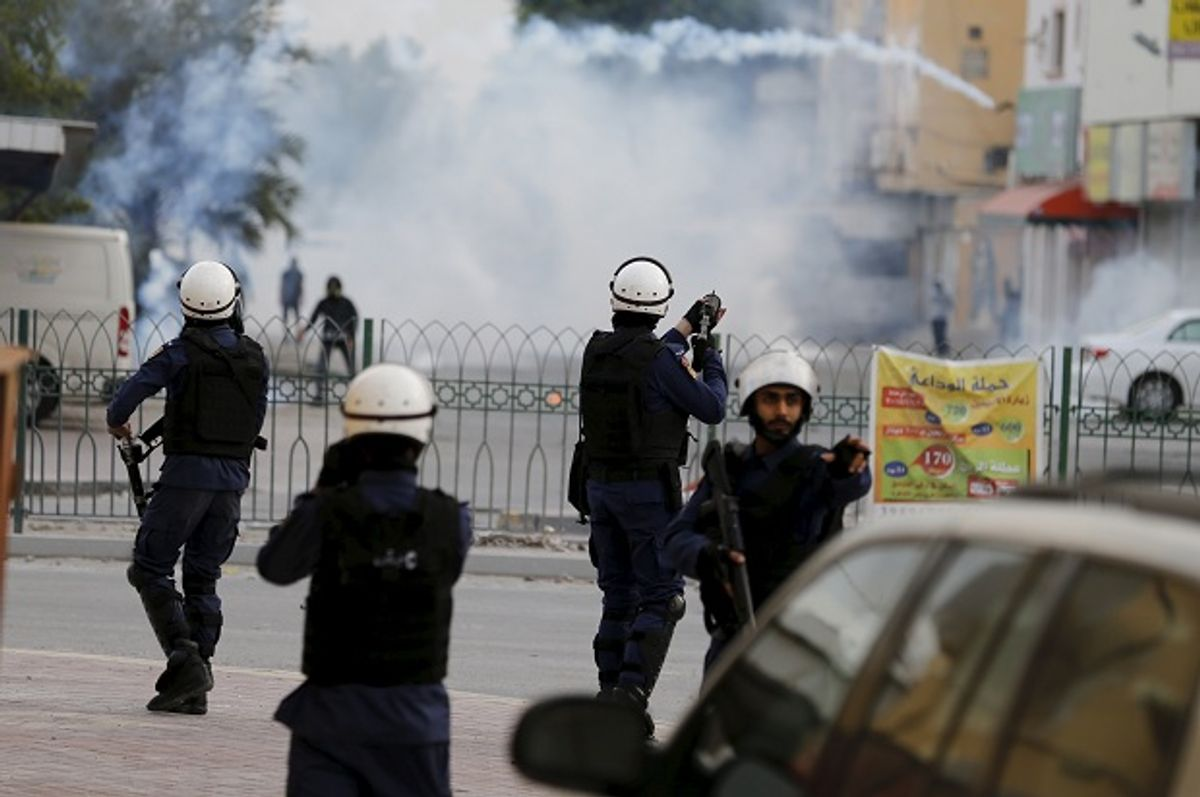 Riot police fire tear gas at protesters in Bahrain on January 5, after Saudi Arabia executed prominent Shia cleric Nimr al-Nimr.  (Reuters/Hamad Mohammed)