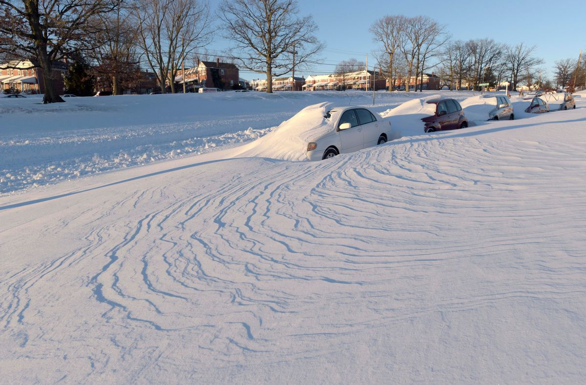 Wind-blown snow buries vehicles, Sunday, Jan. 24, 2016, in Parkville, Md. Millions of Americans were preparing to dig themselves out Sunday after a mammoth blizzard with hurricane-force winds and record-setting snowfall brought much of the East Coast to an icy standstill. (AP Photo/Steve Ruark) (AP)