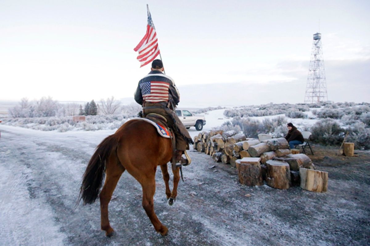 Cowboy Dwane Ehmer, of Irrigon Ore., a supporter of the group occupying the Malheur National Wildlife Refuge, rides his horse at Malheur National Wildlife Refuge Friday, Jan. 8, 2016, near Burns, Ore.   (AP/Rick Bowmer)
