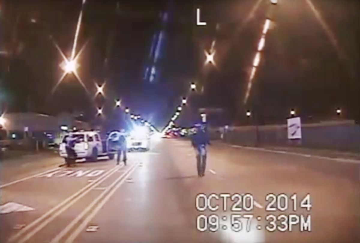 FILE - In this Oct. 20, 2014 frame from dash-cam video provided by the Chicago Police Department, Laquan McDonald, right, walks down the street moments before being shot by officer Jason Van Dyke 16 times in Chicago. (Chicago Police Department via AP, File) (AP)