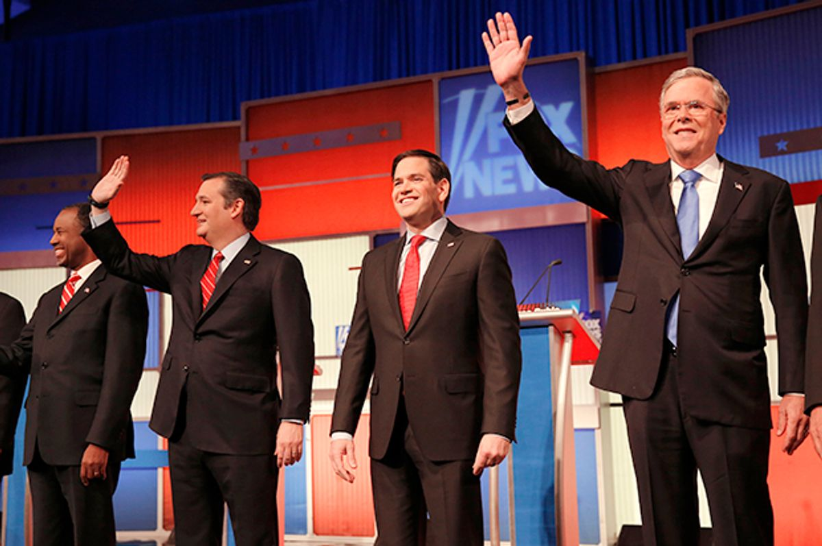 Ben Carson, Ted Cruz, Marco Rubio and Jeb Bush pose together at the start of the Republican debate, January 28, 2015.   (Reuters/Carlos Barria)