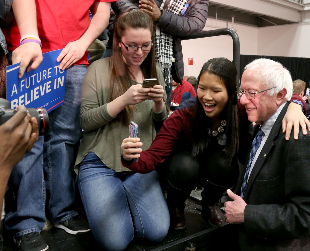 Democratic presidential candidate Sen. Bernie Sanders, I-Vt., poses for photos during a campaign stop, Monday, Jan. 4, 2016, in Manchester, N.H. (AP Photo/Mary Schwalm) (AP)