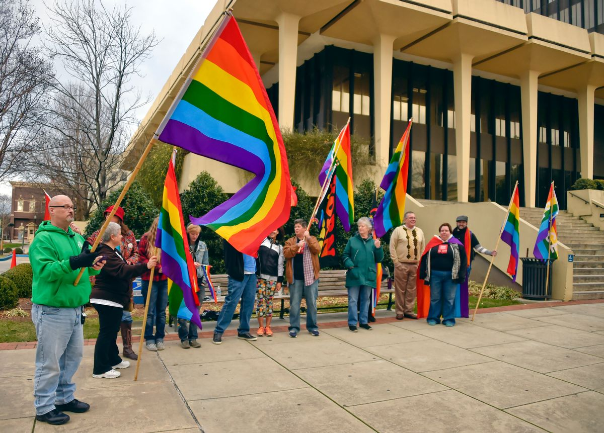 In this photo taken Wednesday, Jan. 6, 2016, Gay marriage activists gather outside the Madison County Courthouse in Huntsville, Ala., to protest Alabama Chief Justice Roy Moore's administrative order saying the Alabama Supreme Court never lifted a March directive to probate judges to refuse marriage licenses to gay couples. (Bob Gathany/AL.com via AP) MANDATORY CREDIT, MAGS OUT, TV OUT (AP)