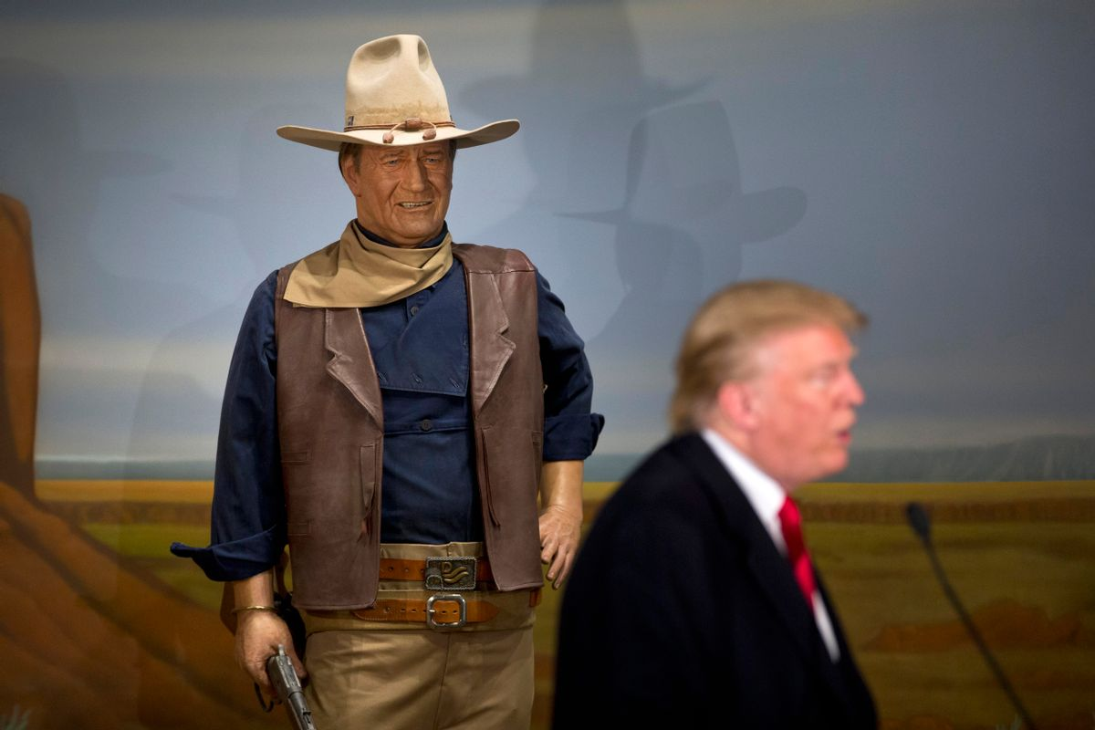 Republican presidential candidate Donald Trump stands in front of a wax statue of John Wayne during a news conference at the John Wayne Museum, Tuesday, Jan. 19, 2016, in Winterset, Iowa. (AP Photo/Jae C. Hong) (AP)
