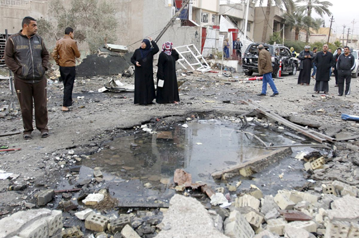 Residents gather at the site of a car bomb blast in New Baghdad, Jan. 12, 2016.    (Reuters/Khalid al Mousily)