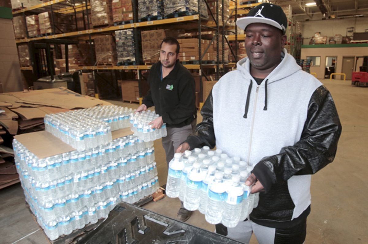 Bottled water is picked up from the Food Bank of Eastern Michigan to deliver to a school after elevated lead levels were found in the city's water in Flint, Michigan December 16, 2015.    (Reuters/Rebecca Cook)