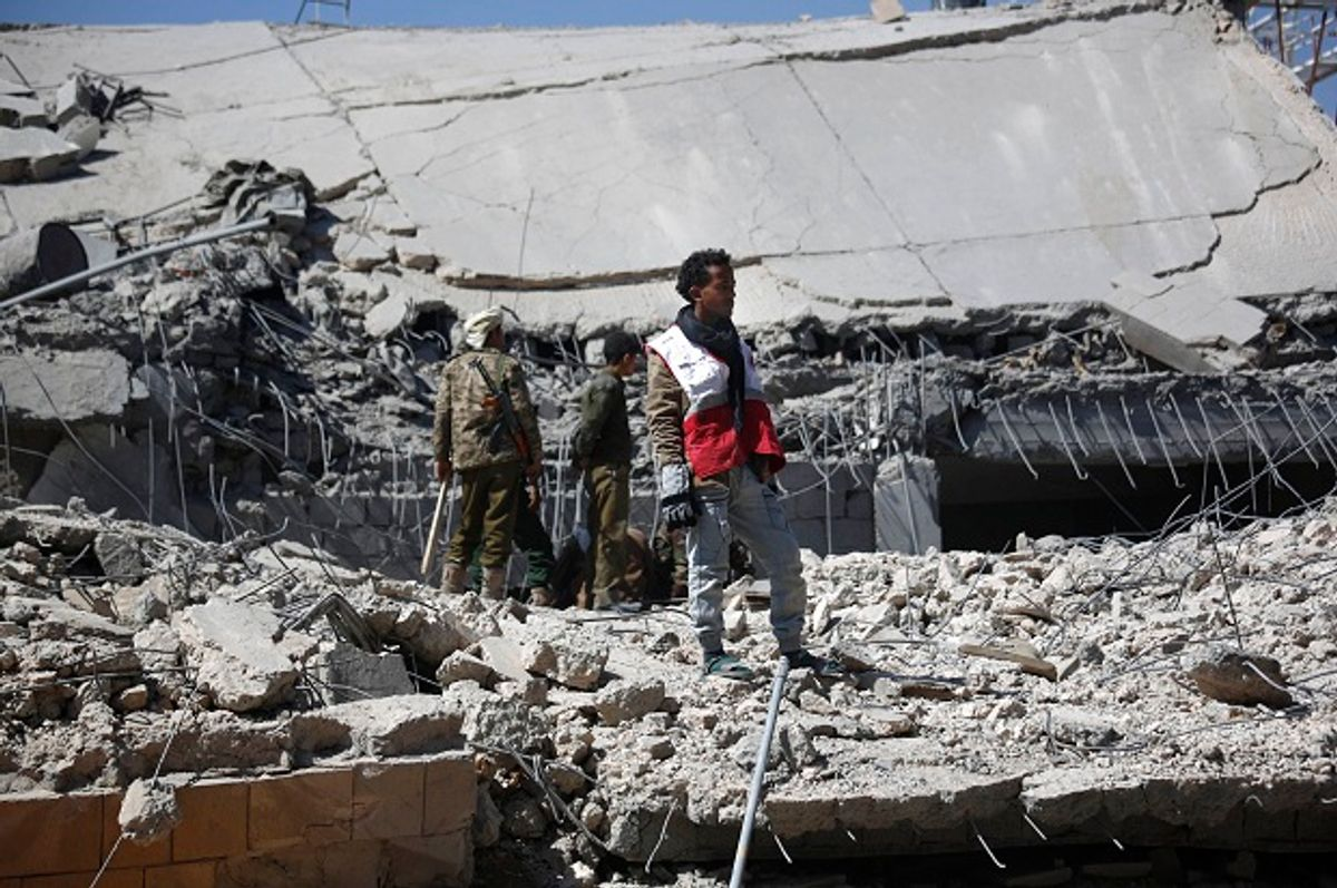 A medic stands on the rubble of the police headquarters after it was destroyed by Saudi-led airstrikes in Sanaa, Yemen, Monday, Jan. 18, 2016.  (AP/Hani Mohammed)