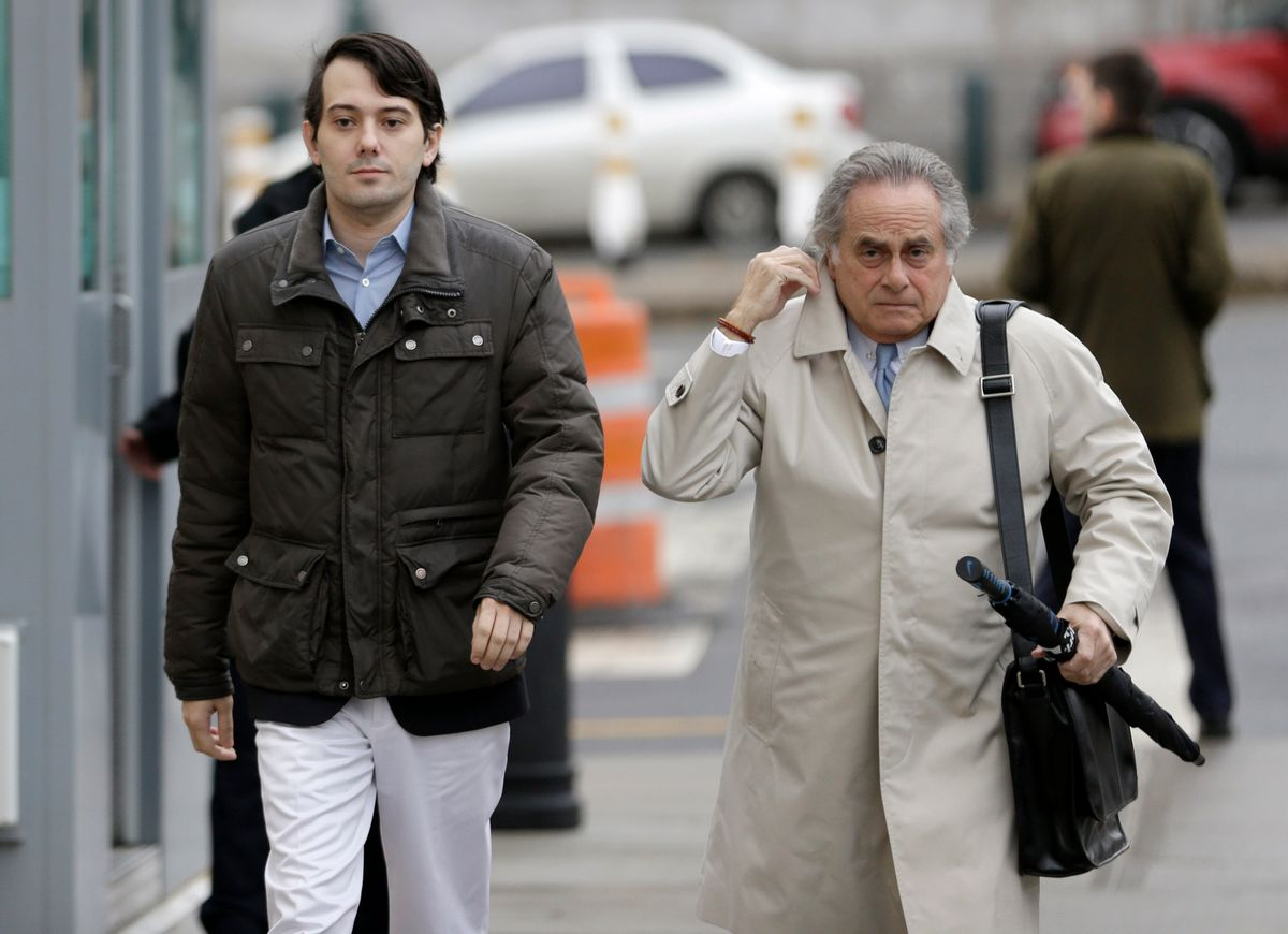 Former Turing Pharmaceuticals CEO Martin Shkreli, left, and his new lawyer Benjamin Brafman arrive at court in New York, Wednesday, Feb. 3, 2016.  (AP)