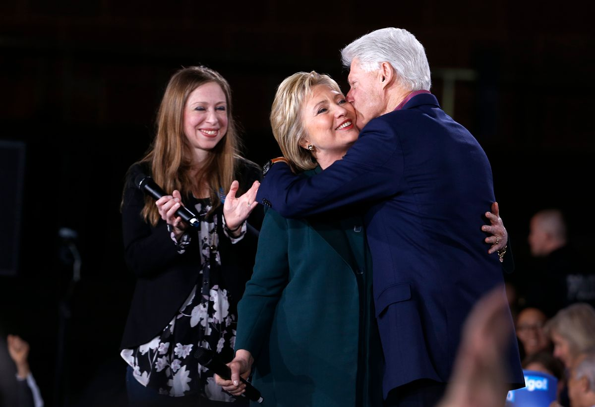 Democratic Presidential candidate Hillary Clinton gets a kiss from her husband and former President Bill Clinton as daughter Chelsea looks on during a rally at the Clark County Government Center Friday, Feb. 19, 2016. (Steve Marcus/Las Vegas Sun VIA AP) (AP)