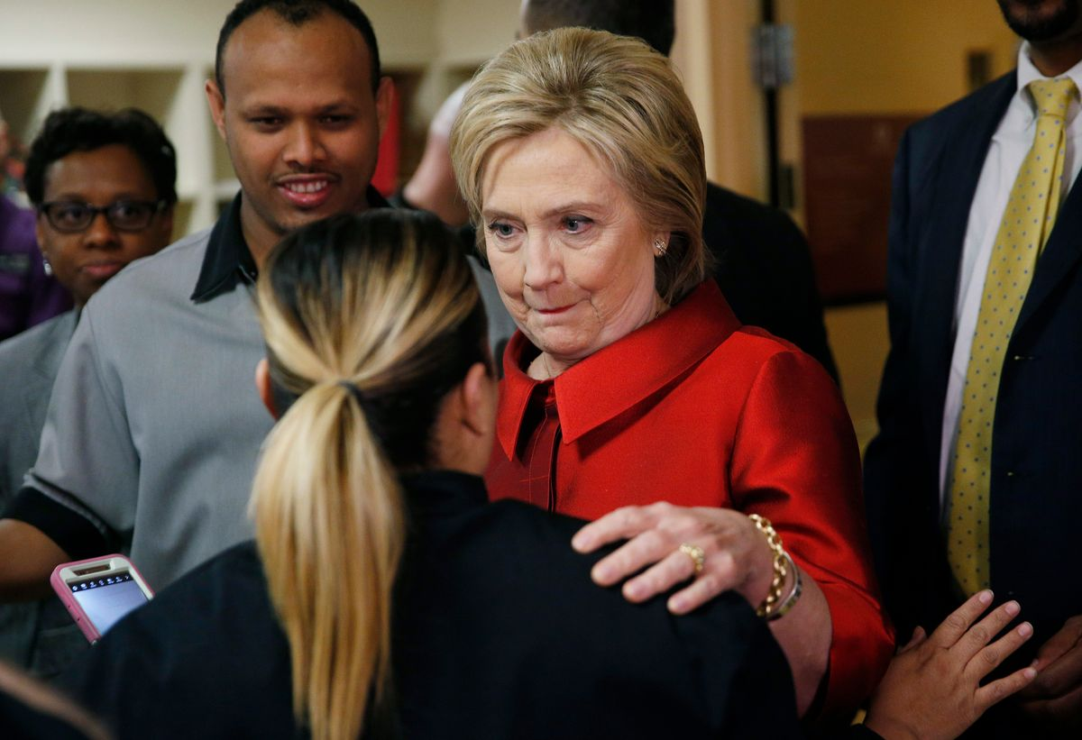 Democratic presidential candidate Hillary Clinton speaks with a Harrah's Las Vegas employee on the day of the Nevada Democratic caucus, Saturday, Feb. 20, 2016, in Las Vegas. (AP Photo/John Locher) (AP)