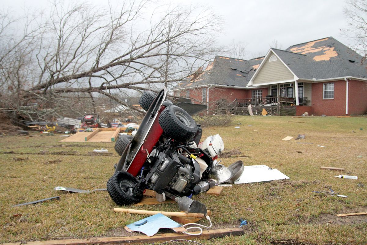 A riding lawn mower lies on the ground after a storm in Collinsville, Miss., Tuesday, Feb. 2, 2016.  (Paula Merritt /The Meridian Star via AP) MANDATORY CREDIT (AP)