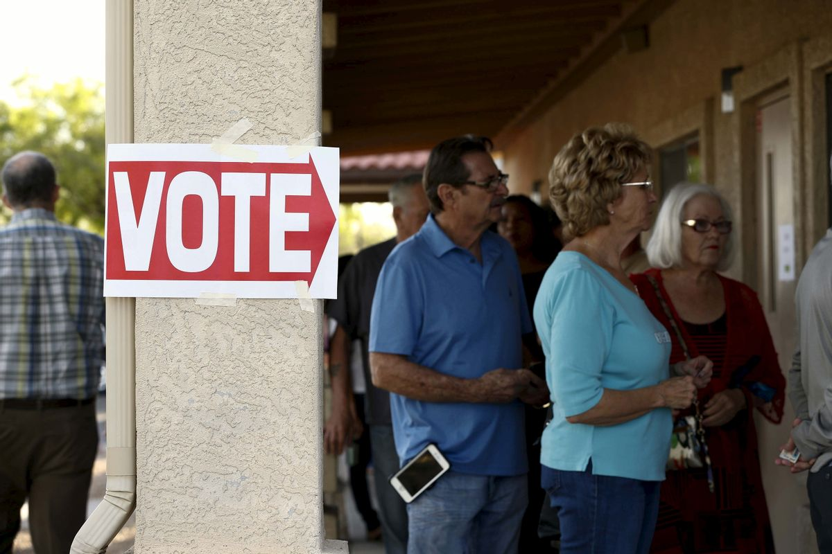 Voters wait in line at a polling site in Glendale, Arizona  (Reuters)