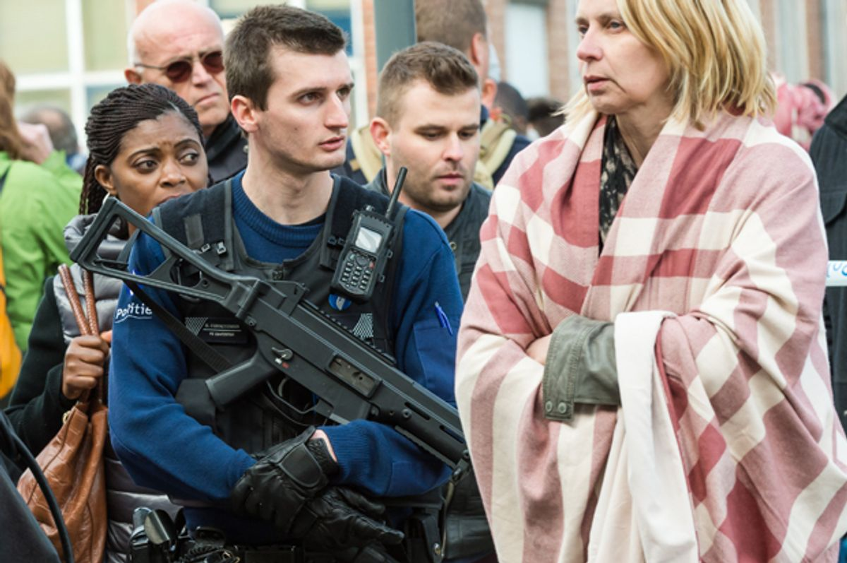 A police officer stands guard as people are evacuated from Brussels airport after explosions, March 22, 2016.   (AP/Geert Vanden Wijngaert)