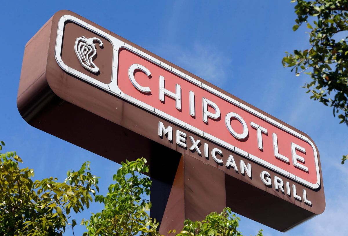 """This Monday, Feb. 8, 2016, photo, shows the sign of a Chipotle restaurant in Hialeah, Fla. Chipotle is using free burrito offers to combat the """"eerie"""" look of empty stores and convince people it's safe to return. The offers come as Chipotle fights to recover from a series of food scares, with sales down 26 percent in February. () (AP Photo/Alan Diaz)"""