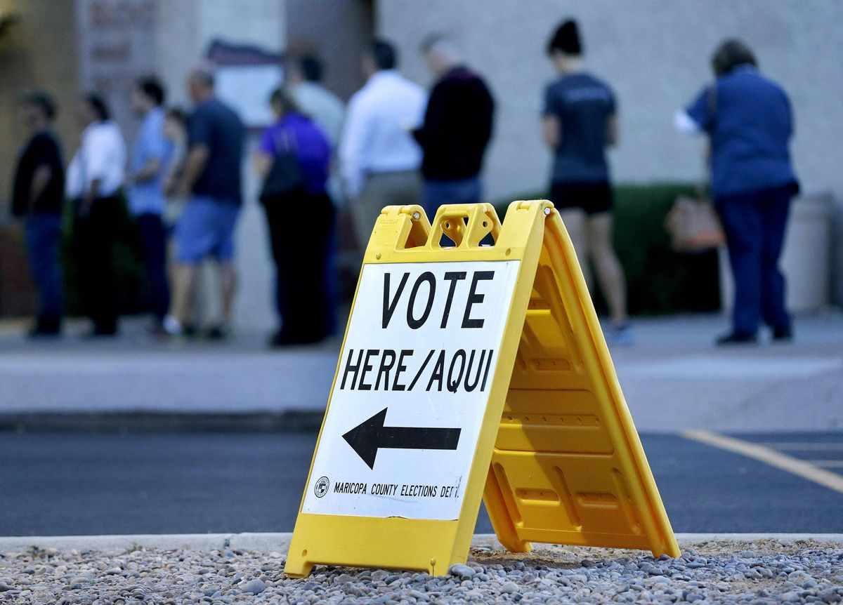 Voters wait in line at dawn to cast their ballot in Arizona's presidential primary election, Tuesday, March 22, 2016, in Phoenix. (AP Photo/Matt York) (AP)