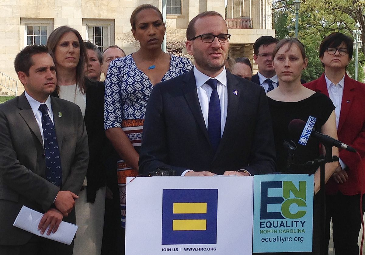 Human Rights Campaign Executive Director Chad Griffin, center, speaks at a news conference at the old state Capitol Building in Raleigh, N.C. on Thursday, March 30, 2016.  (AP/Gary Robertson)