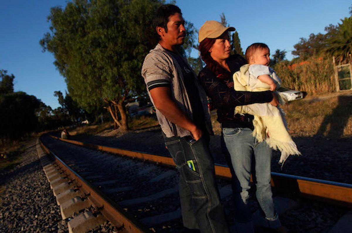 A Salvadoran migrant family on a railway track in Mexico  (Reuters/Edgard Garrido)