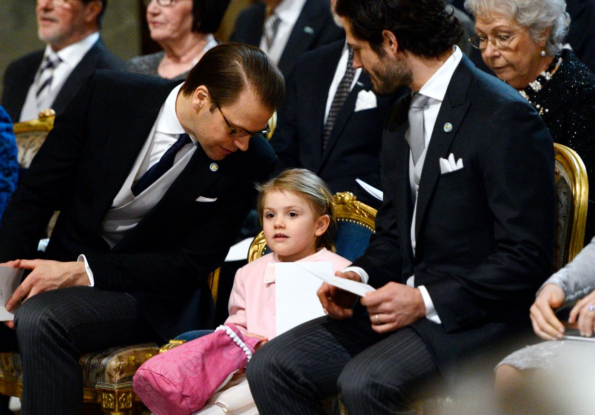 Sweden's Prince Daniel, left, talks to his daughter Princess Estelle as Prince Carl Philip looks on as they attend a thanksgiving service for the newborn prince, the second child of Crown Princess Victoria and Prince Daniel, in the palace church at Stockholm Royal Palace, Thursday March 3, 2016. The royal baby is third in line to the thrown after his mother and elder sister, Princess Estelle. (Anders Wiklund/TT via AP) SWEDEN OUT (AP)